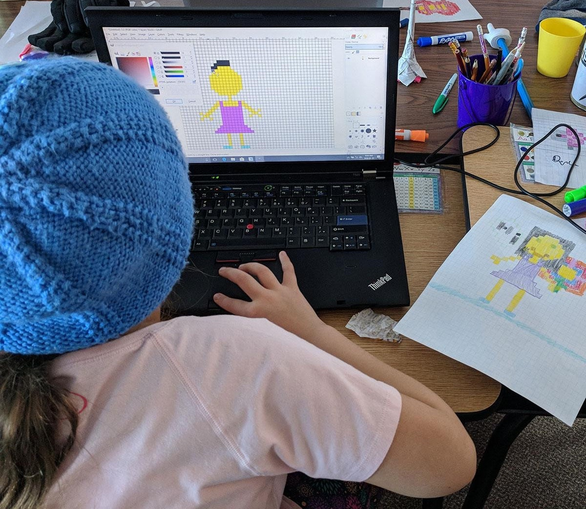 A young girl practices computer design during one of Pinnguaq's workshops (photo: Pinnguaq Association)