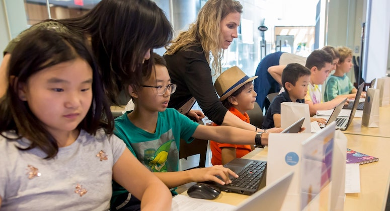 Kids coding in classroom