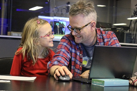 Father and daughter bonding while coding.
